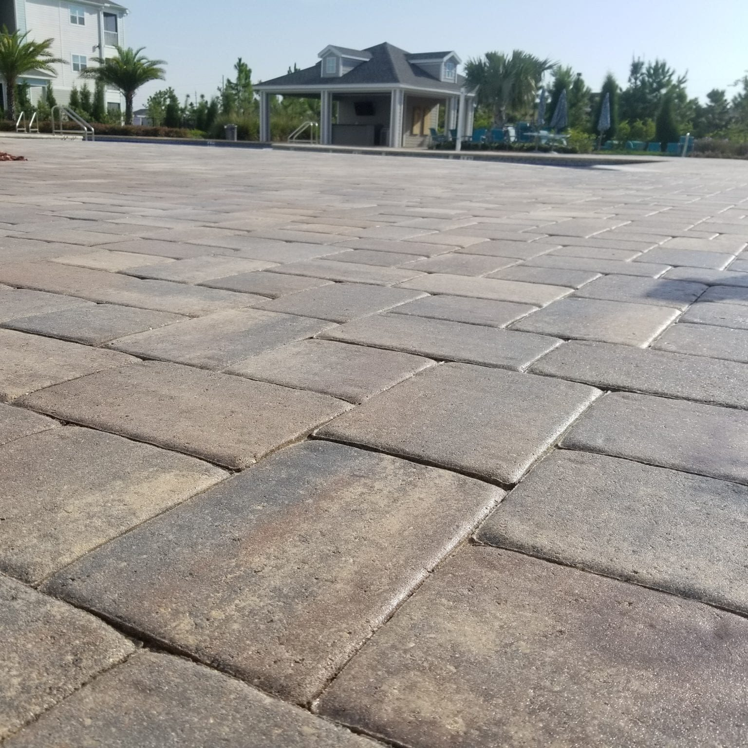 With the right maintenance plan in place, your pavers should last – and look beautiful – for years. Our paver sealing service is a key part of that maintenance plan. We always use a three-step process that will keep your pavers clean, attractive, and well-protected: